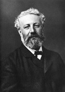 Jules Verne - portrét - Nadar [Public domain or Public domain], via Wikimedia Commons